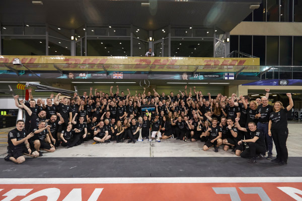 Yas Marina Circuit, Abu Dhabi, United Arab Emirates. Sunday 26 November 2017. Toto Wolff, Executive Director (Business), Mercedes AMG, Valtteri Bottas, Mercedes AMG, 1st Position, his wife Emelia, Lewis Hamilton, Mercedes AMG, 2nd Position, and the Mercedes team celebrate a great race result and another highly successful season. World Copyright: Steve Etherington/LAT Images  ref: Digital Image SNE21325
