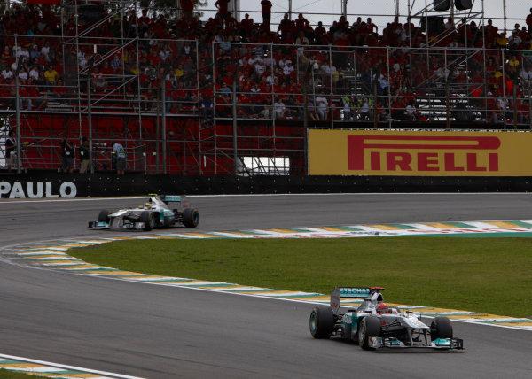 Interlagos, Sao Paulo, Brazil. 27th November 2011. Michael Schumacher, Mercedes GP W02, 15th position, leads Nico Rosberg, Mercedes GP W02, 7th position. Action.  World Copyright: Steve Etherington/LAT Photographic ref: Digital Image SNE25214