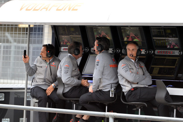 Gary Paffett (GBR) McLaren test driver, Sam Michael (AUS) McLaren Sporting Director and Martin Whitmarsh (GBR) McLaren Chief Executive Officer on the pit wall gantry. Formula One World Championship, Rd9, German Grand Prix, Practice, Nurburgring, Germany, Friday 5 July 2013.