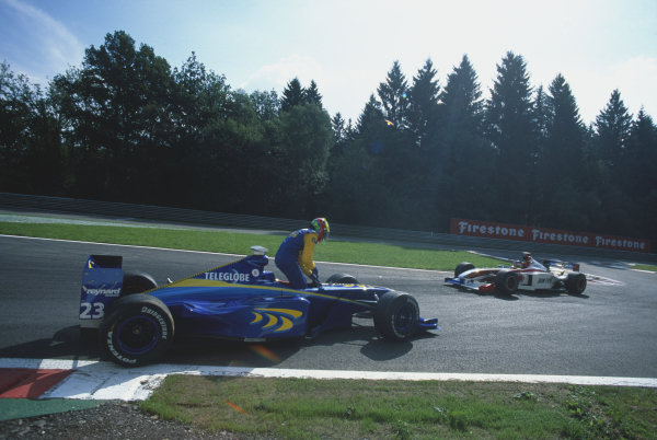 1999 Belgian Grand Prix. Spa-Fracorchamps, Belgium. 27th - 29th August 1999. Rd 12. Ricardo Zonta (BAR 01-Supertec), retired, is passed by team mate, Jacques Villeneuve (BAR 01-Supertec), 15th position, action.  World Copyright: LAT Photographic. Ref:  Colour Transparency.