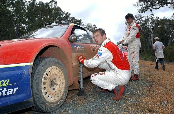 Sebastien Loeb (FRA) Citroen changes a wheel between stages.