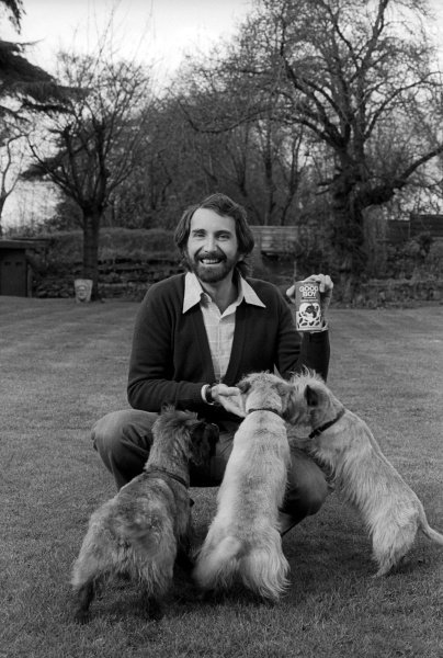 John Watson (GBR) with his pet dogs at home, promoting Good Boy Choc Drops.Lifestyle Feature, 1975 Formula One World Championship.