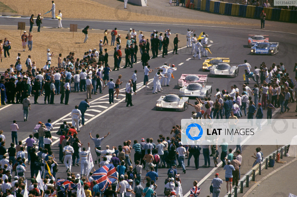 Le Mans, France. 10th - 11th June 1989.Jochen Mass/Manuel Reuter/Stanley Dickens (Sauber C9-Mercedes-Benz), 1st position, leads Mauro Baldi/Kenny Acheson/Gianfranco Brancatelli (Sauber C9-Mercedes-Benz), 2nd position, across the finish line, action. World Copyright: LAT Photographicref: 35mm Transparency Image