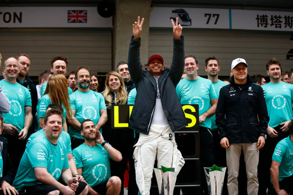 Shanghai International Circuit, Shanghai, China.  Sunday 09 April 2017.  Lewis Hamilton, Mercedes AMG, celebrates victory with Valtteri Bottas, Mercedes AMG and team members. World Copyright: Andrew Hone/LAT Images  ref: Digital Image _ONY6072