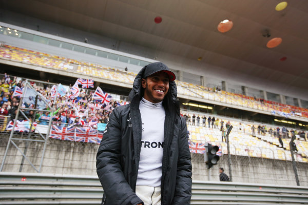 Shanghai International Circuit, Shanghai, China.  Sunday 09 April 2017.  Lewis Hamilton, Mercedes AMG, with fans in the grandstand behind. World Copyright: Charles Coates/LAT Images  ref: Digital Image AN7T0931
