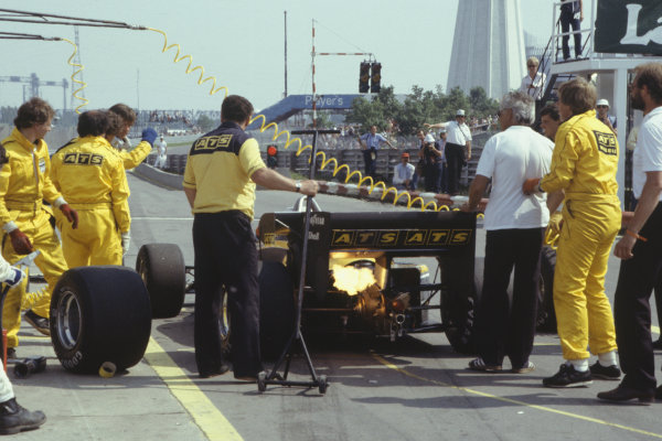 1983 Canadian Grand Prix  Montreal, Canada. 10-12 June 1983.  Manfred Winkelhock, ATS D6 BMW, 9th position, with flaming exhaust in a pit stop.  Ref: 83CAN06. World Copyright - LAT Photographic