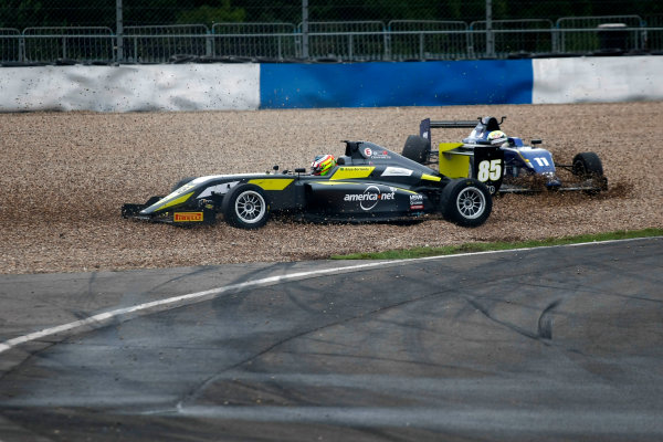2016 BRDC F3 Championship, Donington Park, Leicestershire. 10th - 11th September 2016. Enzo Bortoleto (BRA) Double R Racing BRDC F3 and Ricky Collard (GBR) Carlin BRDC F3 collide at Redgate in race 1. World Copyright: Ebrey / LAT Photographic.