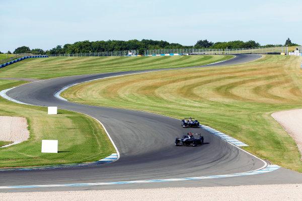 FIA Formula E Season 3 Testing - Day Two. Donington Park Racecourse, Derby, United Kingdom. Jose Maria Lopez, DS Virgin Racing, Spark-Citroen, leads Adam Carroll, Jaguar Racing, Spark-Jaguar. Wednesday 24 August 2016. Photo: Adam Warner / LAT / FE. ref: Digital Image _14P2238