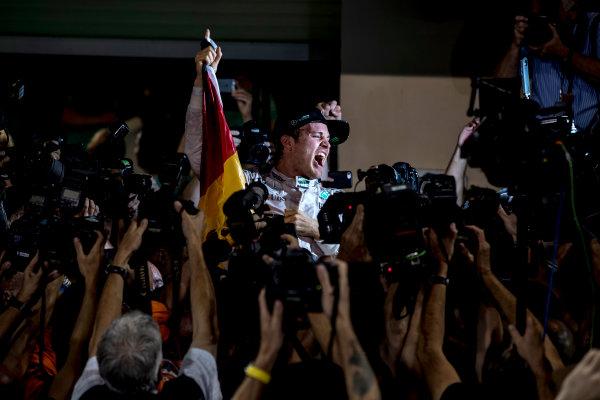Yas Marina Circuit, Abu Dhabi, United Arab Emirates. Sunday 27 November 2016. Nico Rosberg, Mercedes AMG, 2nd Position, celebrates World Championship victory. World Copyright: Glenn Dunbar/LAT Photographic ref: Digital Image _X4I6123
