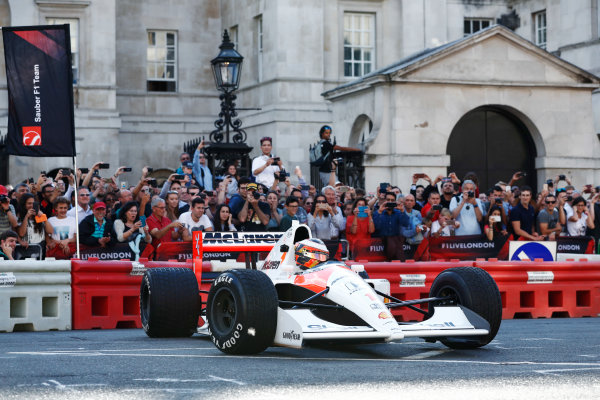 London, United Kingdom.  Wednesday 12 July 2017. Stoffel Vandoorne, McLaren, demonstrates a 1991 McLaren MP4/6 that was raced by Ayrton Senna. World Copyright: Glenn Dunbar/LAT Images  ref: Digital Image _X4I0886