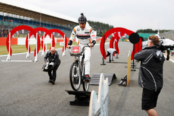Silverstone, Northamptonshire, UK.  Thursday 13 July 2017. Jenson Button, McLaren, takes part in a bicycle-related event. World Copyright: Glenn Dunbar/LAT Images  ref: Digital Image _31I2175