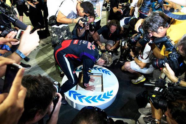 Yas Marina Circuit, Abu Dhabi, United Arab Emirates. Sunday 3rd November 2013. A plaster cast is made of the hands of winner Sebastian Vettel, Red Bull Racing. World Copyright: Charles Coates/LAT Photographic. ref: Digital Image _X5J7972
