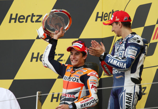 British Grand Prix.  Silverstone, England. 30th August - 1st September 2013.  Jorge Lorenzo, Yamaha, and Marc Marquez, Honda, celebrate on the podium.  Ref: IMG_2486a. World copyright: Kevin Wood/LAT Photographic