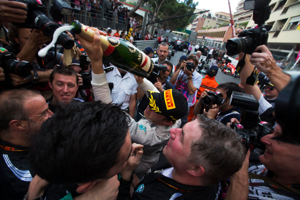 Monte Carlo, Monaco. Sunday 24 May 2015. Nico Rosberg, Mercedes AMG, 1st Position, celebrates in Parc Ferme with Mercedes team mates. World Copyright: Sam Bloxham/LAT Photographic. ref: Digital Image _SBL2778