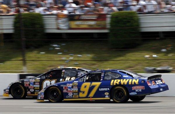 Race winner Kurt Busch (USA) passes Joe Nemechek (USA).NASCAR Nextel Cup Series, Rd20, Pocono, USA, 23-24 July 2005.DIGITAL IMAGE