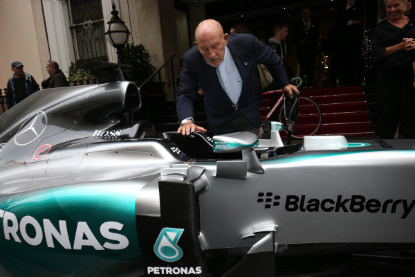 Sir Stirling Moss (GBR) and the Mercedes AMG F1 W06 at BRDC Awards, Great Connaught Rooms, London, 7 December 2015.