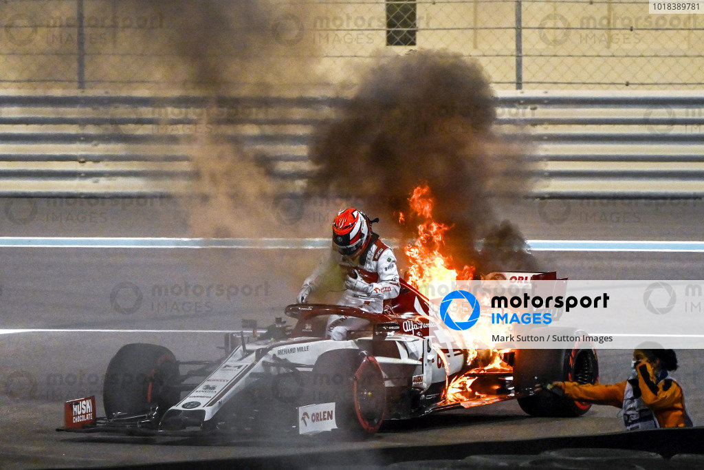 Abu Dhabi GP: Kimi Raikkonen, Alfa Romeo Racing C39, climbs from his car while the rear is engulfed in flames