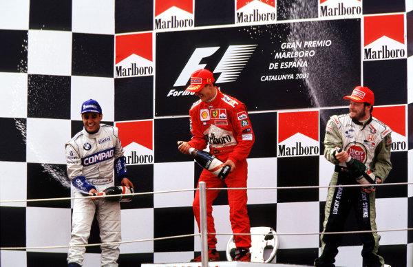 2001 Spanish Grand PrixCatalunya, Barcelona, Spain. 27-29 April 2001.Juan-Pablo Montoya (Williams BMW) 2nd position, Michael Schumacher (Ferrari) 1st position and Jacques Villeneuve (B.A R. Honda) 3rd position, celebrate on the podium.World Copyright: LAT Photographicref: 35mm Image