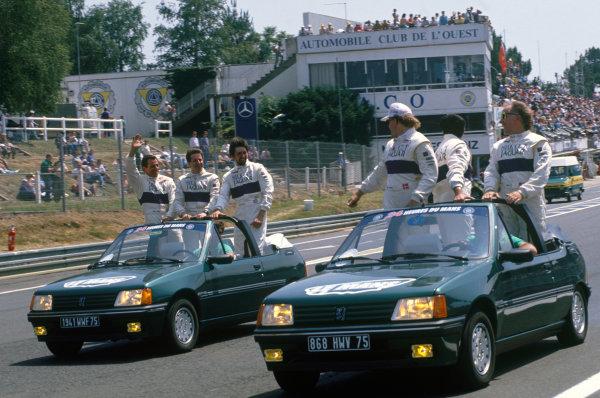 Le Mans, France. 20th - 21st June 1990. Drivers parade, L to R: Alain Ferte/Martin Brundle/David Leslie share a joke with team mates John Nielsen/Eliseo Salazar/Price Cobb, portrait. World Copyright: LAT Photographic. Ref: 90LM21.