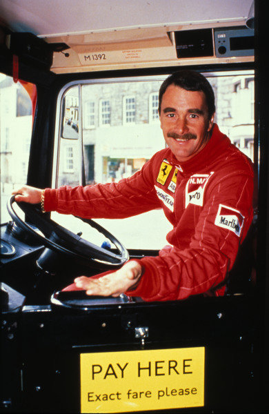 Isle of Man, United Kingdon. 18/4/1989. Nigel Mansell poses for a photo opportunity in the driving seat of an Isle of Man bus