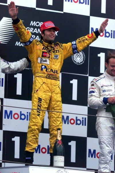 1999 French Grand Prix.Magny-Cours, France.25-27 June 1999. Heinz-Harald Frentzen (Jordan Mugen Honda) celebrates his 1st position on the podium.World Copyright - Coates/LAT Photographic