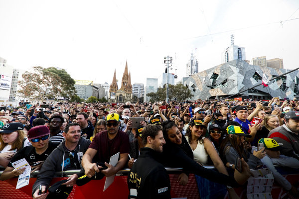 Romain Grosjean, Haas F1 Team take a selfie with a fan at the Federation Square event