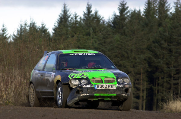 2002 World Rally Championship.Network Q Rally of Great Britain, Cardiff. November 14-17. Gwyndaf Evans on stage 8 after changing a punctured tyre.Photo: Ralph Hardwick/LAT