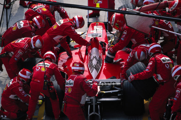 Michael Schumacher, Ferrari F2001, makes a pitstop.