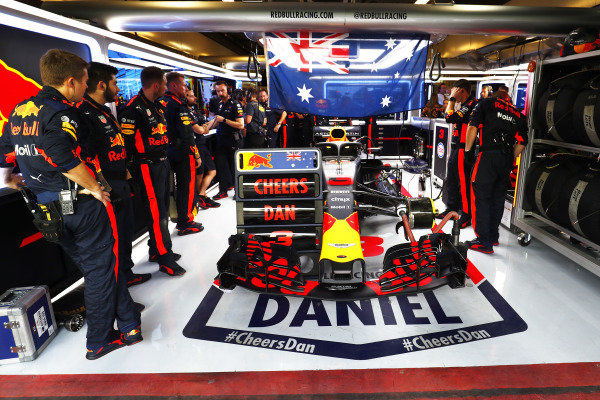 The Red Bull team with a message of support for Daniel Ricciardo, Red Bull Racing RB14, in the garage