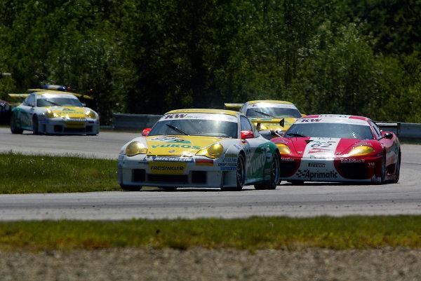 2004 FIA GT ChampionshipBrno, Czech Republic. 30th May 2004.Maassen/Luhr (Porsche 996 GT3-RS) leads Pescatori/Simone (Ferrari 360 Modena), action.World Copyright: Photo4/LAT Photographicref: Digital Image Only