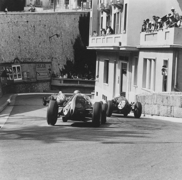 1959 Monaco Grand Prix.Monte Carlo, Monaco. 10 May 1959.Jean Behra (Ferrari Dino 246, #46) leads Stirling Moss (Cooper T51-Climax, #30) and Jack Brabham (Cooper T51-Climax, #24) out of the Station Hairpin. Brabham finished in 1st place. Ref-3969.World Copyright - LAT Photographic