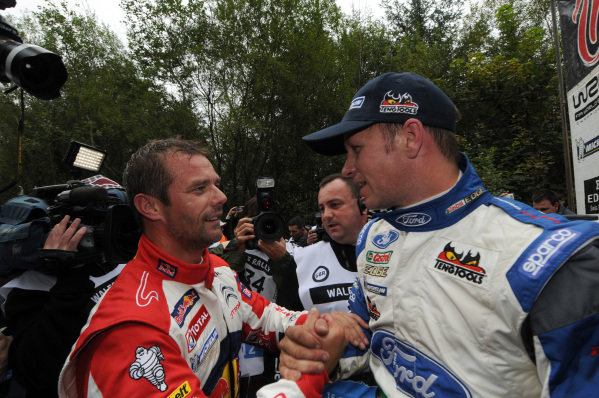 Sebastien Loeb (FRA) and Petter Solberg (NOR) at the end of stage 19.FIA World Rally Championship, Rd10, Wales Rally GB, Day Three, Cardiff, Wales, 16 September 2012.