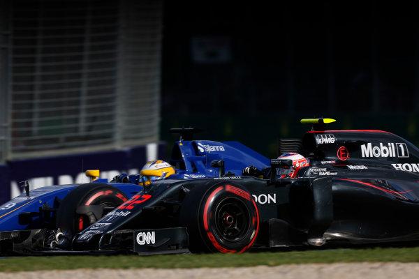 Albert Park, Melbourne, Australia. Sunday 20 March 2016. Marcus Ericsson, Sauber C35 Ferrari, battles with Jenson Button, McLaren MP4-31 Honda. World Copyright: Sam Bloxham/LAT Photographic ref: Digital Image _R6T3761