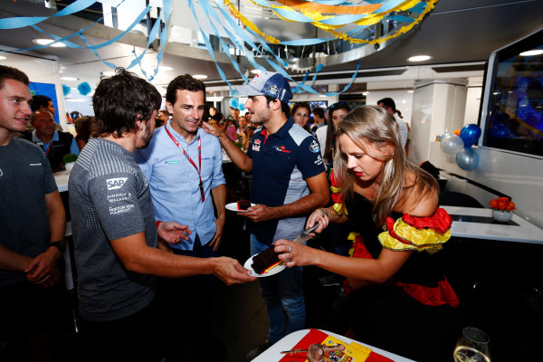 Hungaroring, Budapest, Hungary.  Saturday 29 July 2017. Fernando Alonso, McLaren, celebrates his birthday, with Pedro de la Rosa and Carlos Sainz Jr, Toro Rosso. World Copyright: Andy Hone/LAT Images  ref: Digital Image _ONZ9928