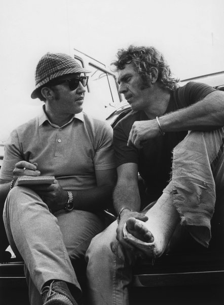Sebring, Florida, USA. 21 March 1970.Steve McQueen nurses his broken foot while Eoin Young interviews him before the 12-hour race at Sebring 1970. He had to cut his overalls to fit over plaster cast, portrait.World Copyright: LAT Photographic.Ref:  Autocar Used Pic 2nd April 1970 Pg 26.