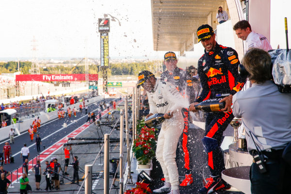 Suzuka Circuit, Japan. Sunday 8 October 2017. Max Verstappen, Red Bull, 2nd Position, Lewis Hamilton, Mercedes AMG, 1st Position, and Daniel Ricciardo, Red Bull Racing, 3rd Position, spray Champagne on the podium. World Copyright: Joe Portlock/LAT Images  ref: Digital Image _L5R9853