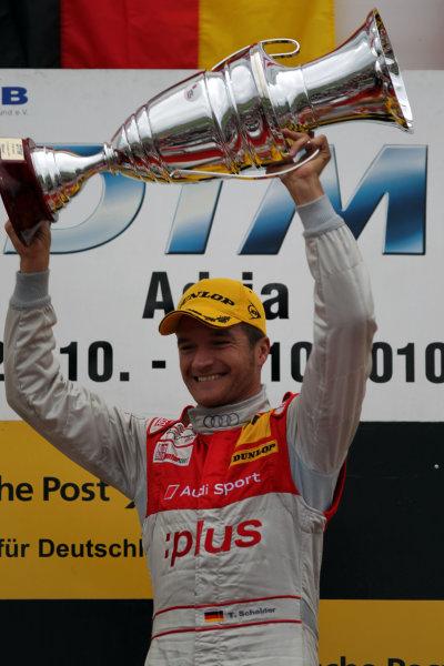 Race winner Timo Scheider (GER), Audi Sport Team Abt celebrates with his trophy on the podium.DTM, Rd10, Adria International Raceway, Italy. 29-31 October 2010 World Copyright: LAT Photographicref: dne1031oc125