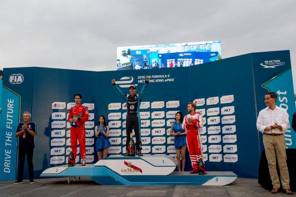 2016/2017 FIA Formula E Championship. Hong Kong ePrix, Hong Kong, China. Sunday 9 October 2016. Lucas Di Grassi (BRA), ABT Schaeffler Audi Sport, Spark-Abt Sportsline, ABT Schaeffler FE02, Sebastien Buemi (SUI), Renault e.Dams, Spark-Renault, Renault Z.E 16 and Nick Heidfeld (GER), Mahindra Racing, Spark-Mahindra, Mahindra M3ELECTRO on the podium. Photo: Zak Mauger/LAT/Formula E ref: Digital Image _L0U2541