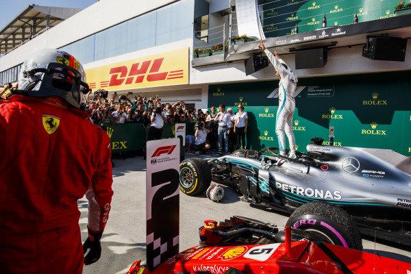 Lewis Hamilton, Mercedes AMG F1 celebrates in Parc Ferme and Sebastian Vettel, Ferrari.