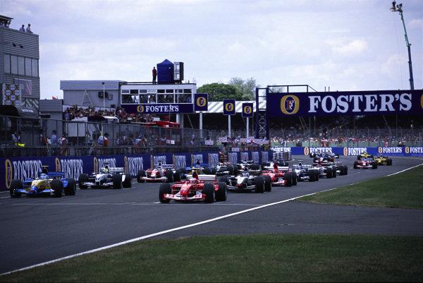 Rubens Barrichello, Ferrari F2003-GA and Jarno Trulli, Renault R23B, on the front row of the grid before the start.