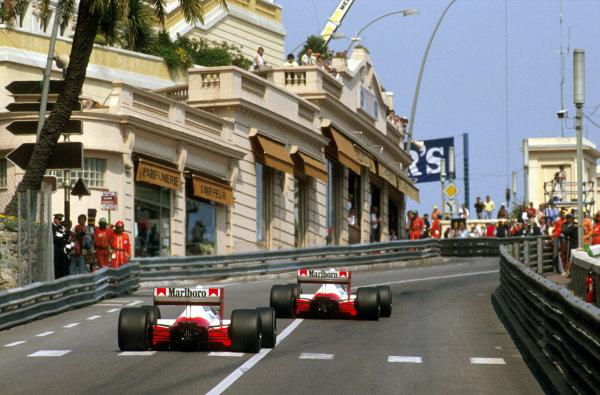 Monte Carlo, Monaco.4-7 May 1989.Ayrton Senna (McLaren MP4/5 Honda) 1st position, leads teammate Alain Prost (McLaren MP4/5 Honda) 2nd position on the climb up Beau Rivage towards Massenet.Ref-89 MON 03.World Copyright - LAT Photographic