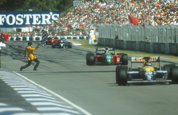 1990 Australian Grand Prix.Adelaide, Australia.2-4 November 1990.Nelson Piquet (Benetton Ford) takes the chequered flag for 1st position, with Nigel Mansell (Ferrari 641) 2nd position not far behind.Ref-90 AUS 06.World Copyright - LAT Photographic