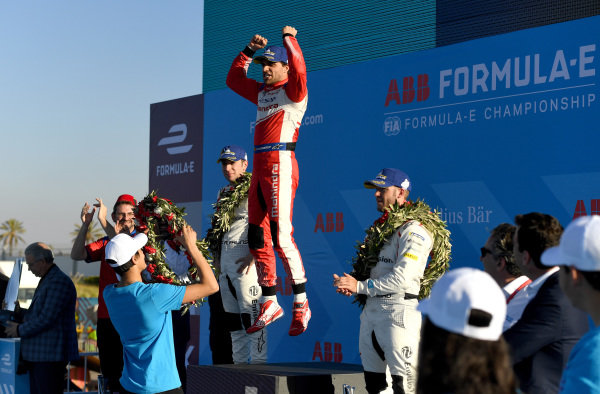 Jérôme d'Ambrosio (BEL), Mahindra Racing, 1st position, leaps in celebration on the podium