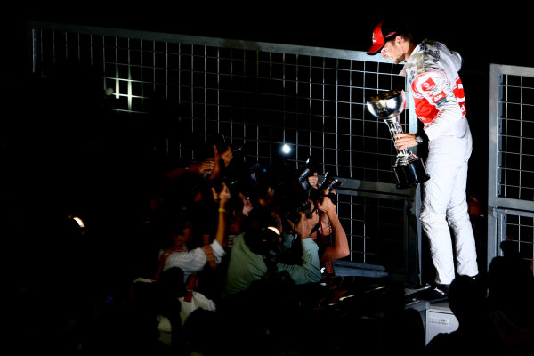 Suzuka Circuit, Suzuka, Japan.9th October 2011.Jenson Button, McLaren MP4-26 Mercedes, 1st position, celebrates with his trophy. Portrait.  World Copyright: Andy Hone/LAT Photographicref: Digital Image CSP25839