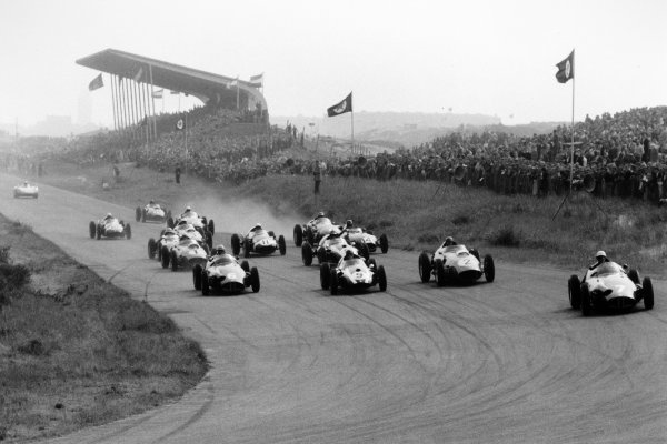 1959 Dutch Grand Prix Zandvoort, Holland. 31 May 1959 Jo Bonnier, BRM P25, 1st position, leads Harry Schell, BRM P25, retired, Masten Gregory, Cooper T51-Climax, 3rd position, Tony Brooks, Ferrari Dino 246, retired, Jack Brabham, Cooper T51-Climax, 2nd position, Jean Behra, Ferrari Dino 246, 5th position, Graham Hill, Lotus 16-Climax, 7th position, and Stirling Moss, Cooper T51-Climax, retired, at the start. Cliff Allison, Ferrari Dino 246, 9th position, Phil Hill, Ferrari Dino 246, 6th position, Innes Ireland, Lotus 16-Climax, 4th position, Roy Salvadori, Aston Martin DBR4/250, retired, Carroll Shelby, Aston Martin DBR4/250, retired, and Maurice Trintignant, Cooper T51-Climax, 8th position, are among those following, with Carel Godin de Beaufort, Porsche RSK, 10th position, having only just left the line, action World Copyright: LAT PhotographicRef: Autosport b&w print. Published: Autosport, 5/6/1959 p725