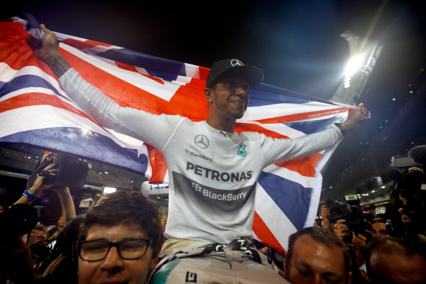 Yas Marina Circuit, Abu Dhabi, United Arab Emirates. Sunday 23 November 2014. Lewis Hamilton, Mercedes AMG, 1st Position, celebrates 2014 title success with his team. World Copyright: Andy Hone/LAT Photographic. ref: Digital Image _ONY2514