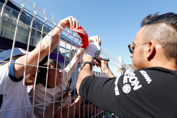 Monte Carlo, Monaco. Wednesday 20 May 2015. Lewis Hamilton, Mercedes AMG, signs autographs for fans. World Copyright: Alastair Staley/LAT Photographic. ref: Digital Image _R6T7609