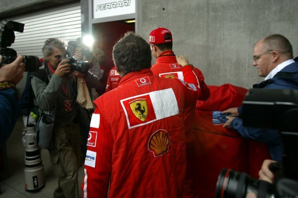 Jean Todt (FRA) Ferrari General Manager and Michael Schumacher (GER) Ferrari go back to the Ferrari pit after the race.Formula One World Championship, Rd15, United States Grand Prix, Race Day, Indianapolis, USA, 28 September 2003.DIGITAL IMAGE