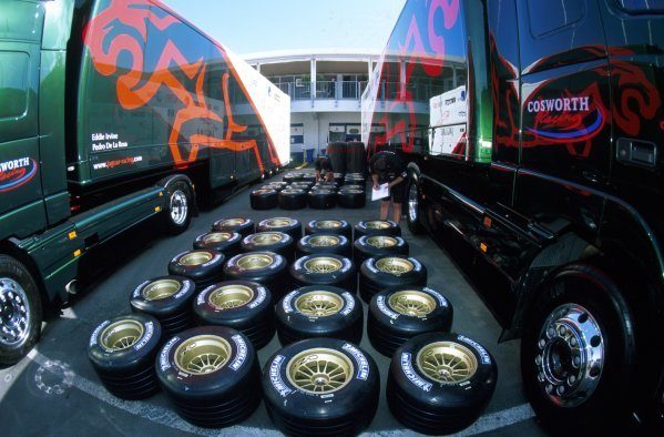Jaguar technicians check wheels and tyres for the Jaguar team behind the pit garages.