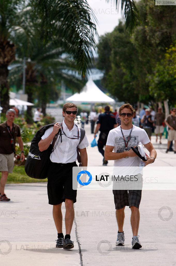 Sepang, Kuala Lumpur, Malaysia2nd April 2009Jenson Button, Brawn GP BGP001 Mercedes arrives in the paddock with his trainer. Portrait.World Copyright: Glenn Dunbar/LAT Photographicref: Digital Image _O9T0500